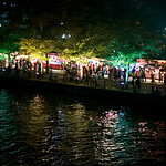 Osaka Tenjin Matsuri 2012. The river is lined with food stalls.