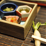 At Daikonya in Kagurazaka Tokyo. They use mini-real daikon for their chopstick rests.